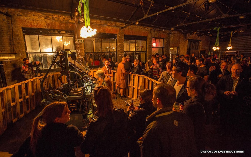The Linotype machine in action at the launch party at M C Motors