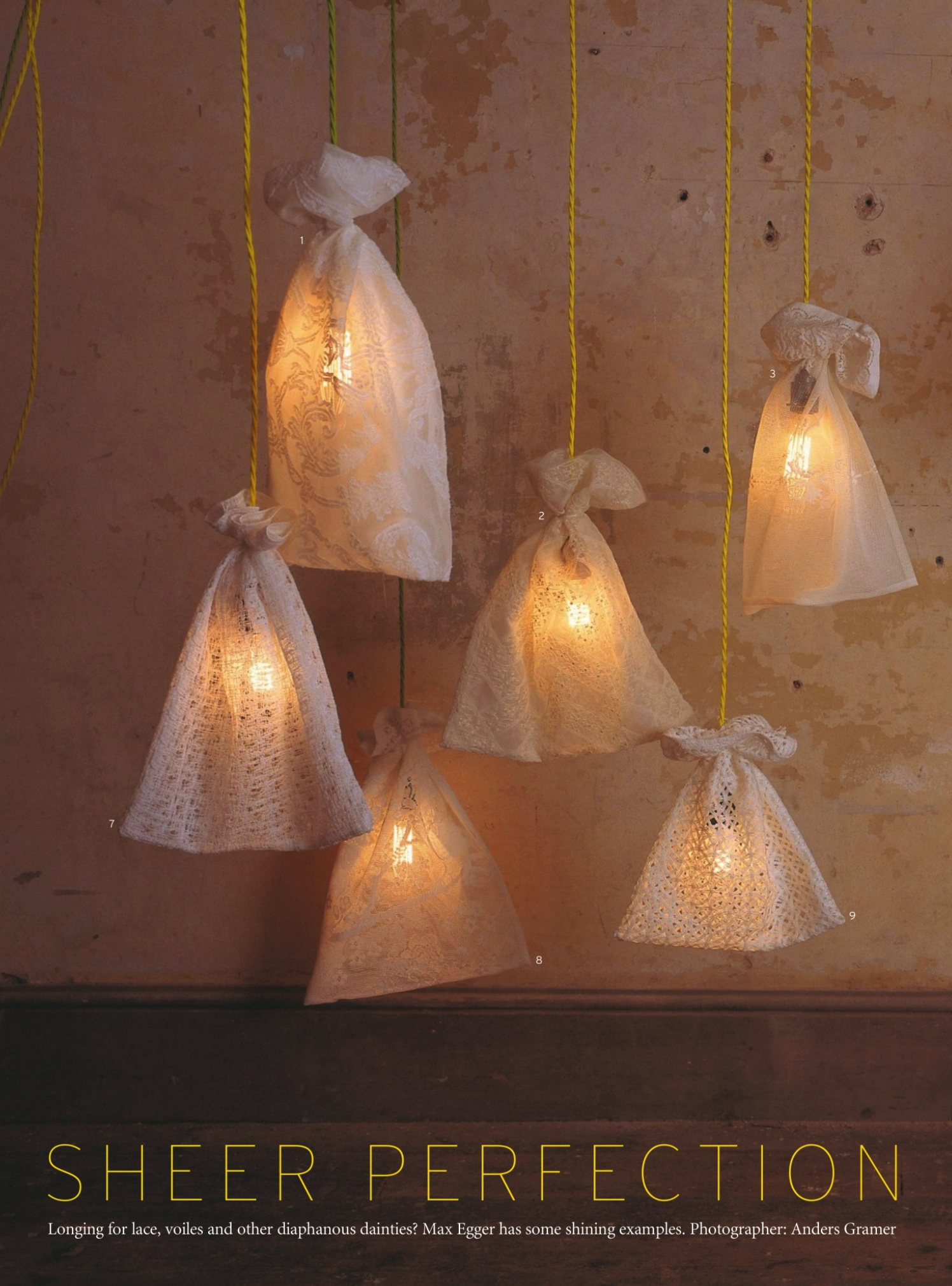 filament light bulbs hung from yellow twist fabric cable