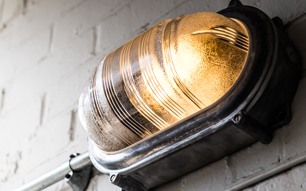 An ingress protection (IP) rated bulkhead style wall light.