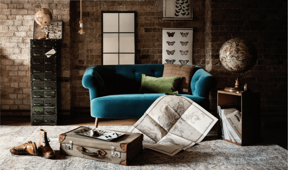 An excerpt from Warehouse Home, a stylish interior with brick wall backdrop