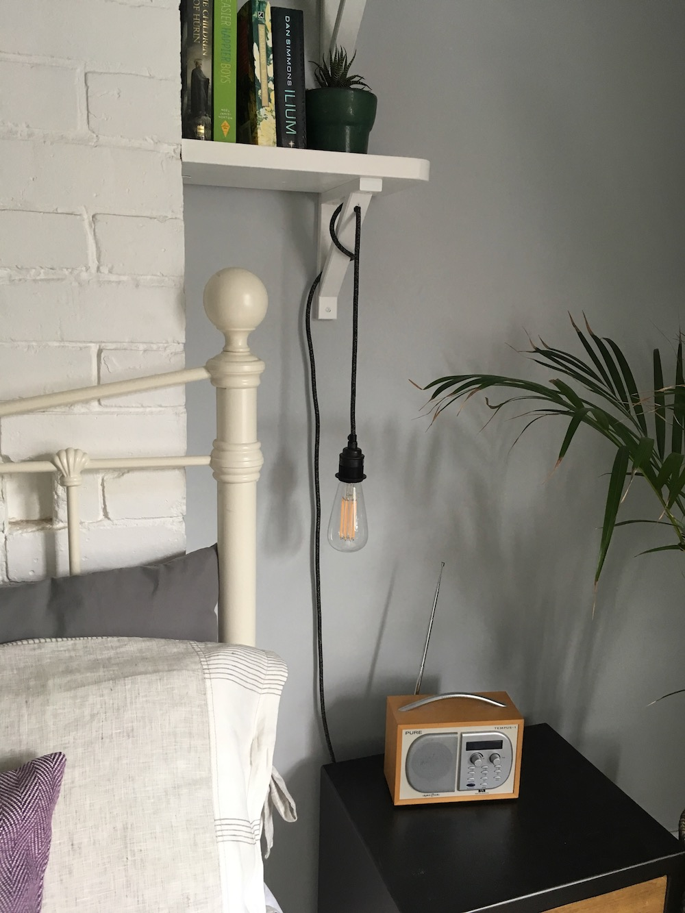 plug in pendant light above bedside table