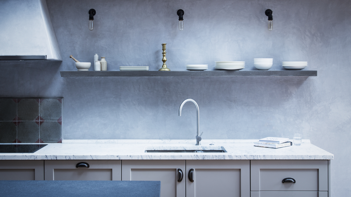 Wall lights in a kitchen providing task lighting above the work surface and ambient lighting for the room