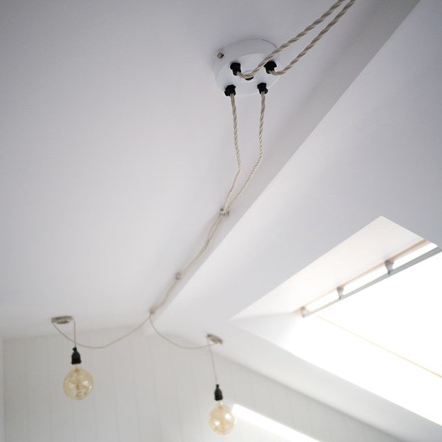 white multiple outlet ceiling roses in the loft conversion