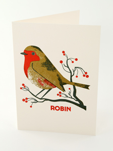 Christmas card by Chris Andrews featuring a winter robin