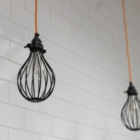 Maclean Interiors kitchen lit by filament lights and bulb guards