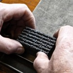 A block of loose type being handled