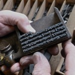 A compositor's stick into which movable type is being assembled