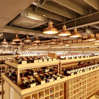 The central wine displays lit by rows of copper reflectors.