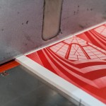 Mondo*arc cards on press being guillotined
