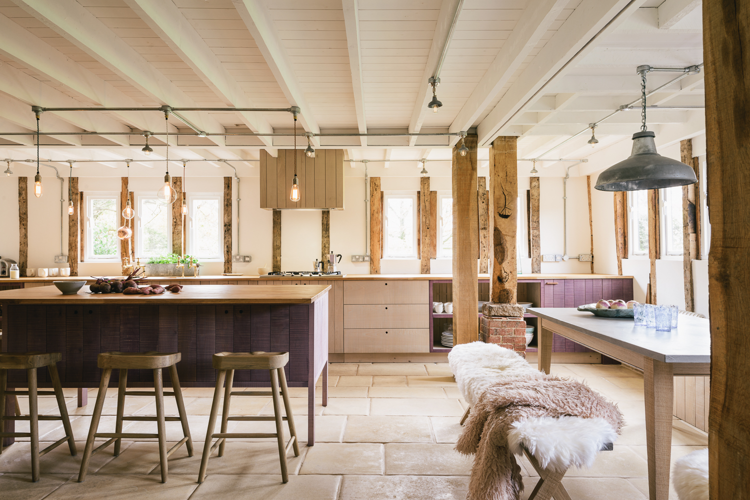 A bank of pendants employed above a kitchen island