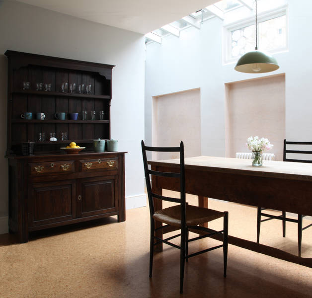 Light dining room with stoneware on sideboard