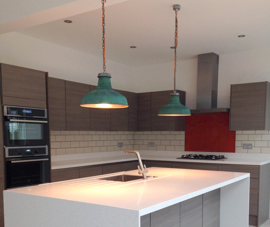 Pendant lights above a kitchen island and sink unit
