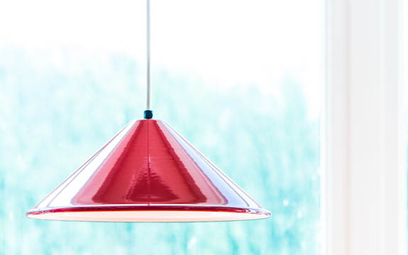 red enamel coolie shade in window